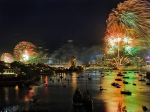 Wide view over Berrys bay of Sydney harbour on New Year night during NYE celebration fireworks highlighting CBD and Harbour bridge